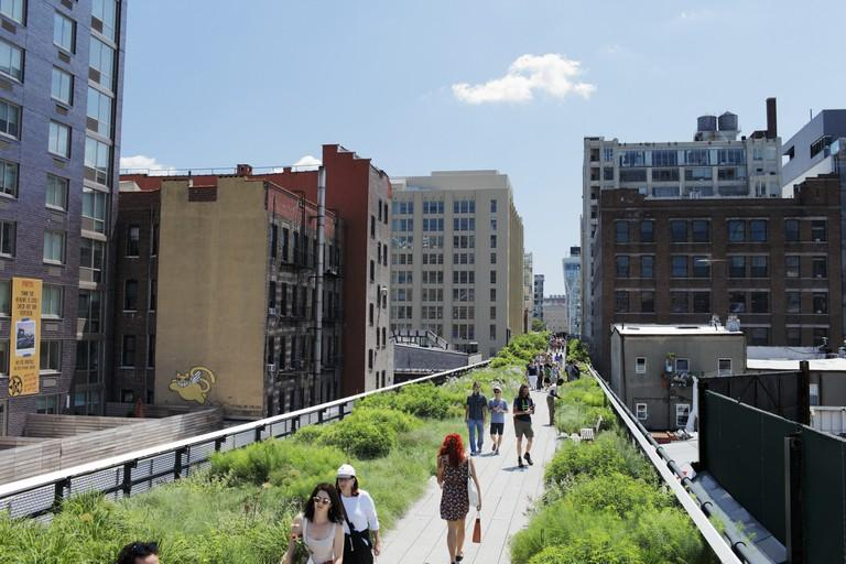 The High Line is a New York City park built on a section of the former elevated New York Central Railroad.